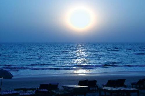 Baga Beach, moon set