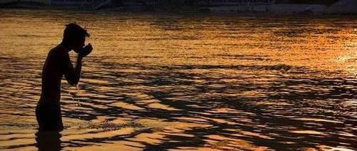 India river ganges man, sunset