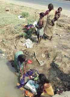 Poverty in India family washing