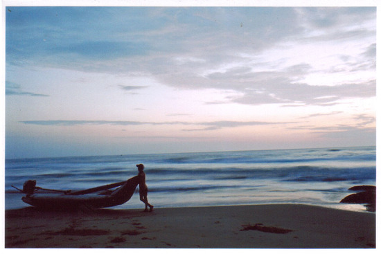 Kovalam beach, Man with Boat amazing sky
