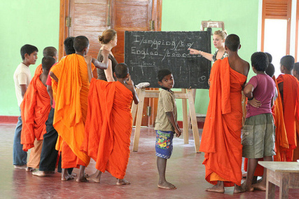 Woman teaching english in India, Volunteer