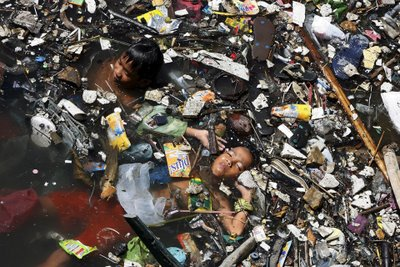 Child in Polluted Ganges river, india